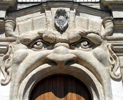 Angry monsters decorate this palazzo.