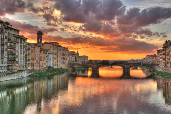 Sunset clouds over Arno River in Florence Italy