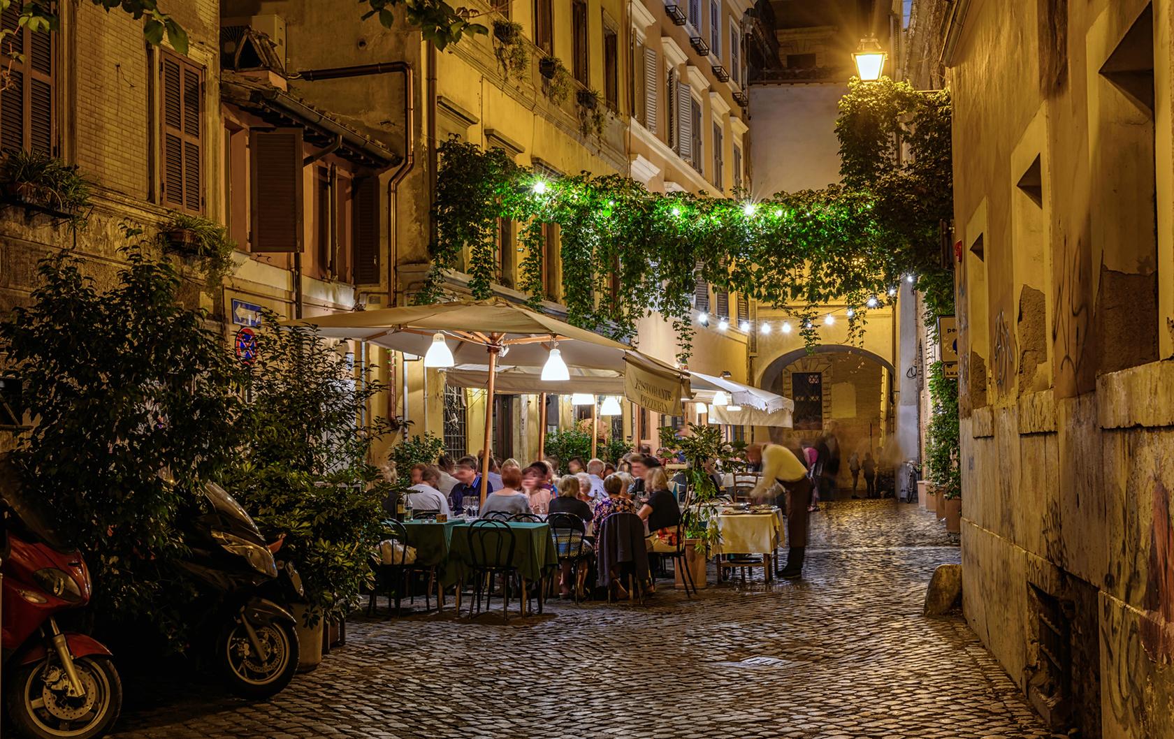 Outdoor restaurant at night in Trastevere